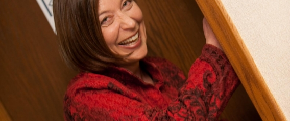 Karen Ostrov smiling - entering office door